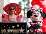 singer katy perry speaks next to minnie mouse