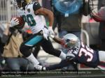 jaguars corey grant was tackled by devin mccourty