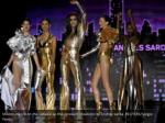 models dance on the catwalk as they present