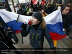 supporters of alexei navalny walk along a street