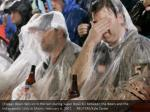 chicago bears fans sit in the rain during super