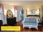 first floor master bedroom w bay window facing