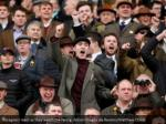 racegoers react as they watch the racing action 1