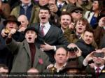 racegoers react as they watch the racing action