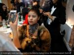 a model gets ready backstage before the metoo