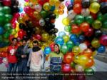 men hold balloons for sale during afghan spring