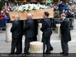 pallbearers carry the coffin into great st marys