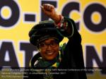 winnie mandela gestures to supporters at the 54th