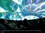concertgoers watch a projection inside