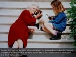 barbara bush pets her dog millie while waiting