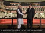 chinese president xi jinping r shakes hands with 1