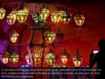a man takes a picture of a vesak lantern