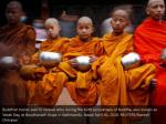 buddhist monks wait to receive alms during