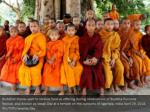 buddhist monks wait to receive food as offering