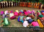 devotees pray after offering food to the buddhist