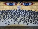 pigeons rest at the dome of boudhanath stupa