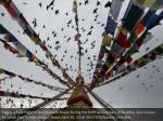 pigeons take flight at boudhanath stupa during