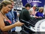 a gun enthusiast inspects handguns reuters lucas