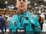 a gun enthusiast wears a handgun themed shirt