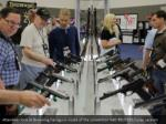attendees look at browning handguns inside