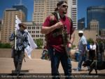 gun advocates carry assault rifles during an open