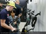 gun enthusiasts inspect a rifle at the daniel