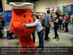 a berkshire hathaway shareholder hugs a kool