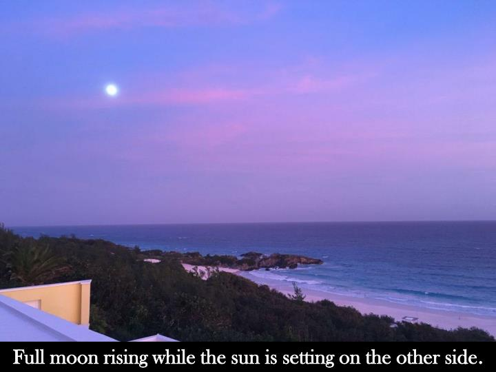 full moon rising while the sun is setting n.