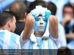an argentina fan after their loss to france