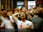 england fans react as they watch the match