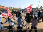 residents wave the u s national flag as they