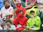 fans wearing teletubbies suits eat strawberries