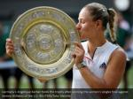 germany s angelique kerber holds the trophy after