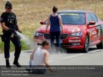 a police officer pepper sprays a protester