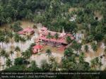 an aerial view shows partially submerged houses