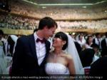a couple attends a mass wedding ceremony