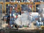 smoke is seen among containers damaged by typhoon