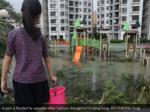 a park is flooded by seawater after typhoon