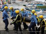 firemen carry a covered body near the sai kung