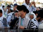 a jewish worshipper prays during a priestly