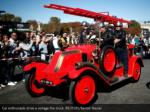 car enthusiasts drive a vintage fire truck