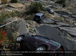 cars as seen on a broken road after an earthquake
