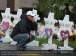 a man reacts at a makeshift memorial outside