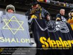 fans hold signs at pittsburgh s heinz field
