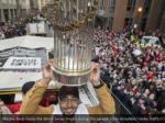 mookie betts hoists the world series trophy