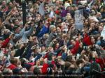 red sox fans cheer for players on tremont street