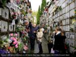 people visit derio cemetery on all saints
