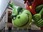 a grinch float hovers above the crowd reuters