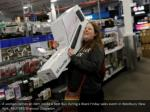 a woman carries an item inside a best buy during