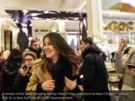 a woman smiles while shopping during a black